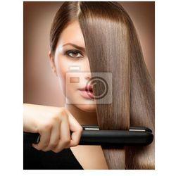 Fototapeta Hairstyling.Hairdressing.Hair prostowania włosów Irons.Straight