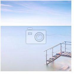 Fototapeta Drewniane molo Drabina do wody morskiej. Długa ekspozycja .