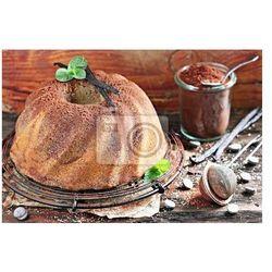 Fototapeta Ciasto czekoladowe z wanilii na wiejskim drewnianym stole