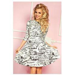 49-4 Rozkloszowana sukienka z rękawkiem 3