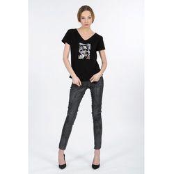 spodnie jeans woskowany