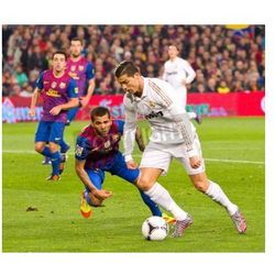 Fototapeta BARCELONA - JANUARY 25: Dani Alves and Cristiano Ronaldo in action during the Spanish Cup match between FC Barcelona