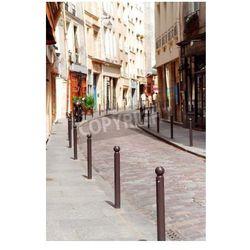 Fototapeta Małe brukowiec bruk ulicy w historycznym centrum Paryża
